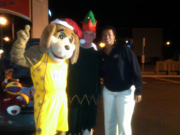 Sparky from the Los Angeles Sparks joined Garth the Elf at the Stuff-A-Bus event at Gateway Plaza Center in Woodland Hills Friday. <span class=meta>(KABC)</span>