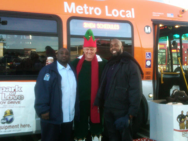 Metro bus drivers joined Garth the Elf at the Stuff-A-Bus event at Gateway Plaza Center on Dec. 10, 2010 Friday.  <span class=meta>(KABC)</span>
