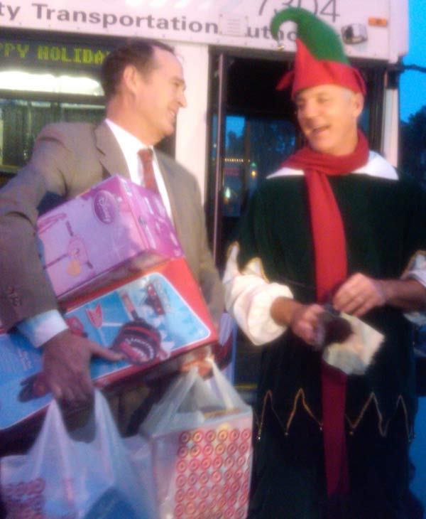 Anaheim Mayor Tom Tait poses with Garth the Elf at the Stuff-A-Bus event at The Honda Center in Anaheim on Friday, Dec. 17, 2010. <span class=meta>(KABC)</span>