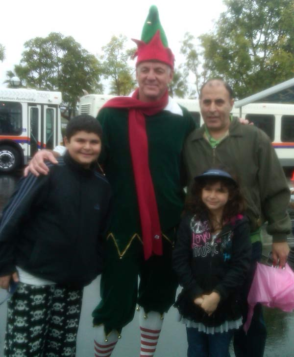 "<div class=""meta image-caption""><div class=""origin-logo origin-image ""><span></span></div><span class=""caption-text"">Posing with Garth the Elf at the Stuff-A-Bus event at The Honda Center in Anaheim on Friday, Dec. 17, 2010. (KABC)</span></div>"