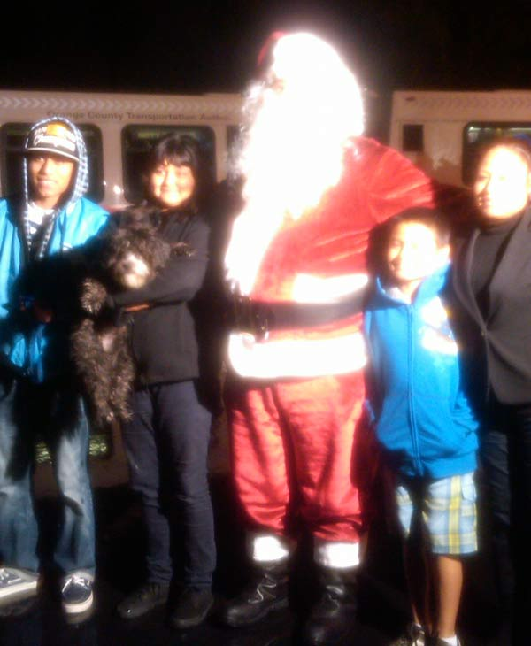 Posing with Santa at the Stuff-A-Bus event at The Honda Center in Anaheim on Friday, Dec. 17, 2010. <span class=meta>(KABC)</span>