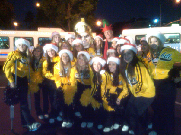High school cheerleaders join Garth the Elf at the Stuff-A-Bus event at the Honda Center in Anaheim on Friday, Dec. 17, 2010. <span class=meta>(KABC)</span>