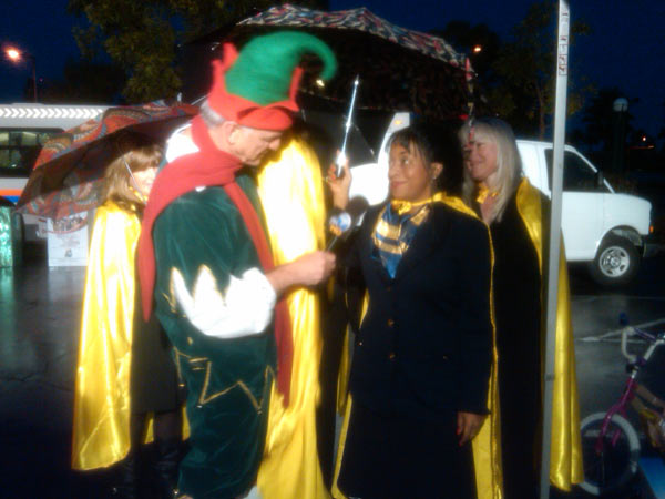 Garth the Elf talks to a woman from Yellow Pages at the Stuff-A-Bus event at the Honda Center in Anaheim on Friday, Dec. 17, 2010. <span class=meta>(KABC)</span>