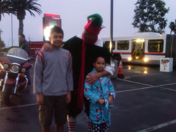 Young boys join Garth the Elf at the Stuff-A-Bus event at the Honda Center in Anaheim on Friday, Dec. 17, 2010. <span class=meta>(KABC)</span>