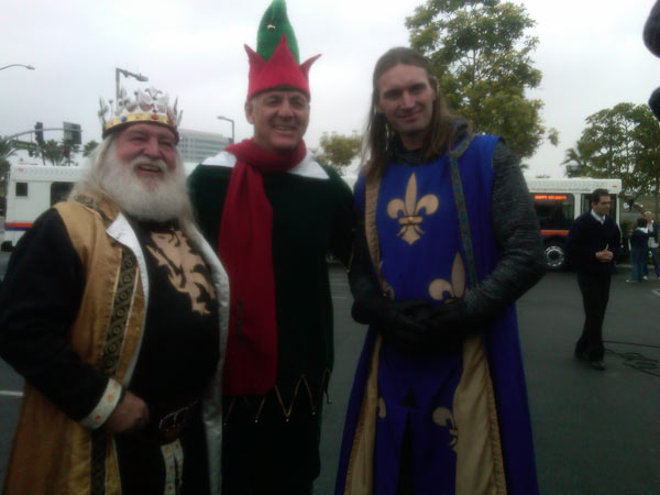 "<div class=""meta ""><span class=""caption-text "">Employees from Medieval Times are pictured with Garth the Elf at the Stuff-A-Bus event at the Honda Center in Anaheim on Friday, Dec. 17, 2010. (KABC)</span></div>"