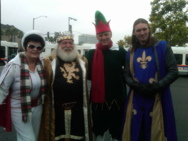 "<div class=""meta ""><span class=""caption-text "">Employees from Medieval Times and an Elvis Presley impersonator are pictured with Garth the Elf at the Stuff-A-Bus event at the Honda Center in Anaheim on Friday, Dec. 17, 2010. (KABC)</span></div>"