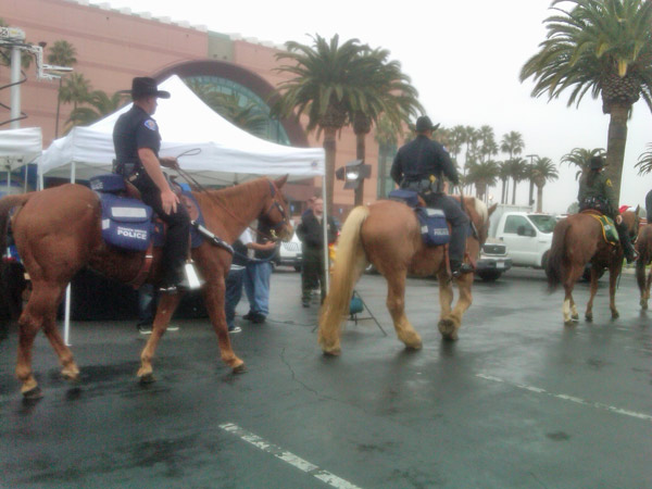 Officers with the Garden Grove Police Department attend the Stuff-A-Bus event at the Honda Center in Anaheim on Friday, Dec. 17, 2010. <span class=meta>(KABC)</span>