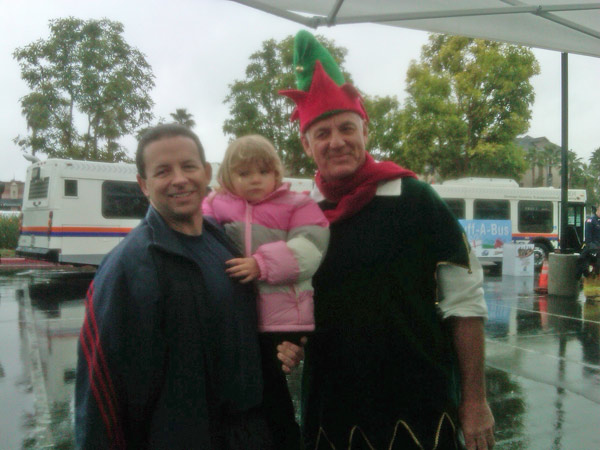 Little Hailey poses with Garth the Elf at the Stuff-A-Bus event at The Honda Center in Anaheim on Friday, Dec. 17, 2010. <span class=meta>(KABC)</span>