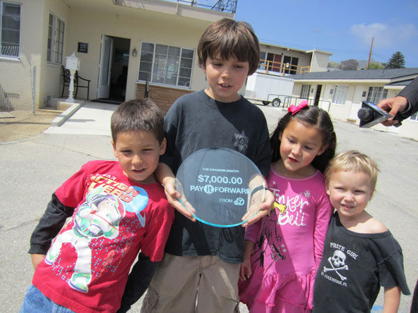 The Kingdom Center: The kids at the Kingdom Center pose with the &#36;7,000 &#39;Pay It Forward token.&#39;  Read more about the Kingdom Center. <span class=meta>(KABC Photo)</span>