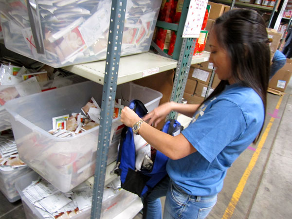 Giving Children Hope - We&#39;ve Got Your Back: A volunteer prepares a backpack for a child in need at the Giving Children Hope warehouse.  Read more about the We&#39;ve Got Your Back Program. <span class=meta>(KABC)</span>