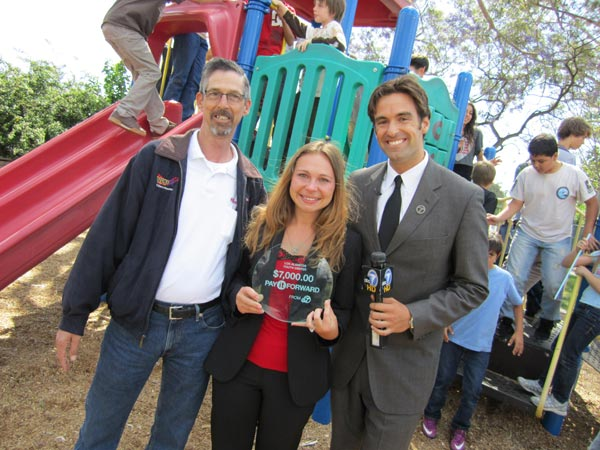 The Los Alamitos Youth Center: Executive director Lina Lumme and Tim Johnson, who nominated the Youth Center, pose with the children.  Read more about the Los Alamitos Youth Center. <span class=meta>(KABC)</span>
