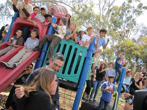 The Los Alamitos Youth Center: The kids celebrate the news with executive director Lina Lumme.  Read more about the Los Alamitos Youth Center. <span class=meta>(KABC)</span>