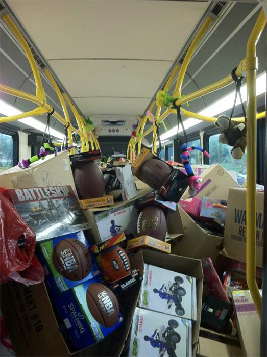Footballs and other toys are seen on a bus at...