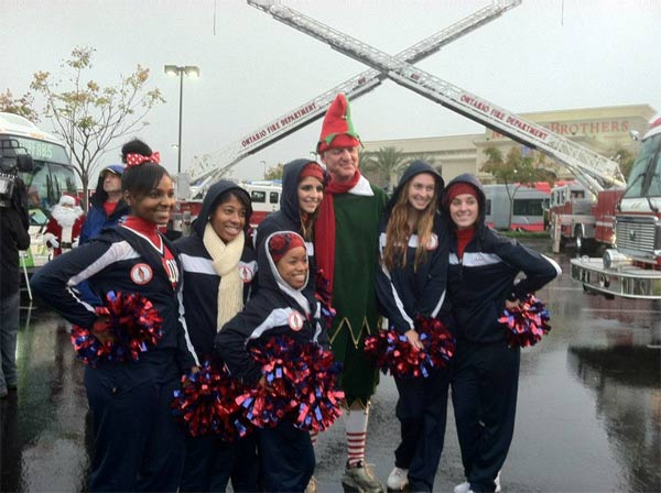 "<div class=""meta ""><span class=""caption-text "">Garth the Elf and cheerleaders at the Spark of Love Toy Drive in Ontario on Friday, Nov. 30, 2012. (KABC)</span></div>"
