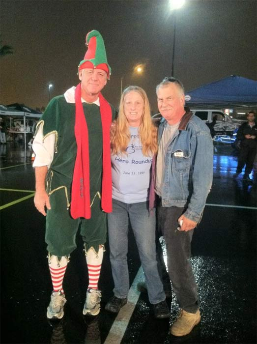 Garth the Elf poses for a photo at Spark of Love Toy Drive in Ontario on Friday, Nov. 30, 2012.
