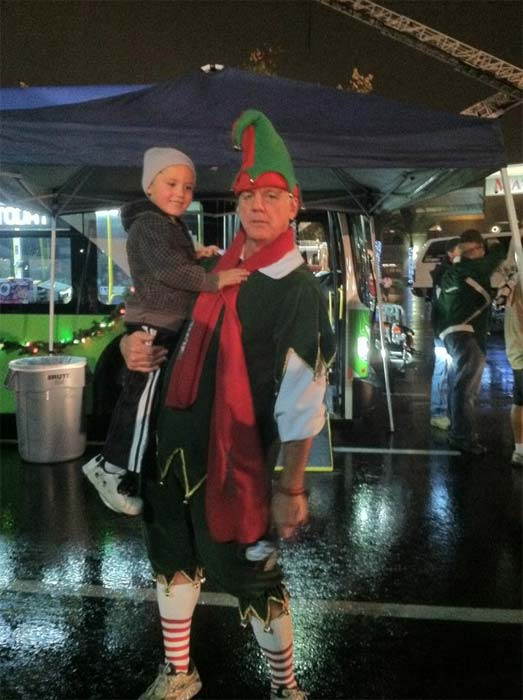 Garth the Elf poses with a boy at the Spark of Love Toy Drive in Ontario on Friday, Nov. 30, 2012. <span class=meta>(KABC)</span>