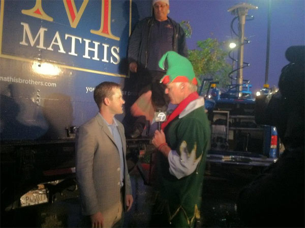 Garth the Elf talks to Rit Mathis at the Spark of Love Toy Drive in Ontario on Friday, Nov. 30, 2012.
