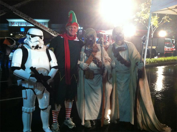 Garth the Elf and Stormtroopers at the Spark of Love Toy Drive in Ontario on Friday, Nov. 30, 2012.