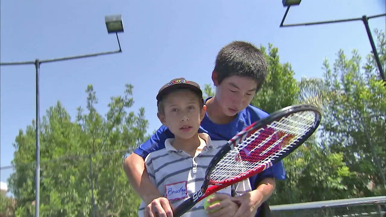 Cool Kid Ryan Teng started No-Limitz Tennis in Irvine. Its a camp that brings the fun game to special needs kids.