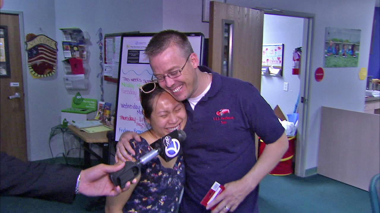 Scott Randell (right) is seen embracing Jenni Luu (left) after he shared part of his grocery winnings from ABC7 with her in this August 2012 photo.