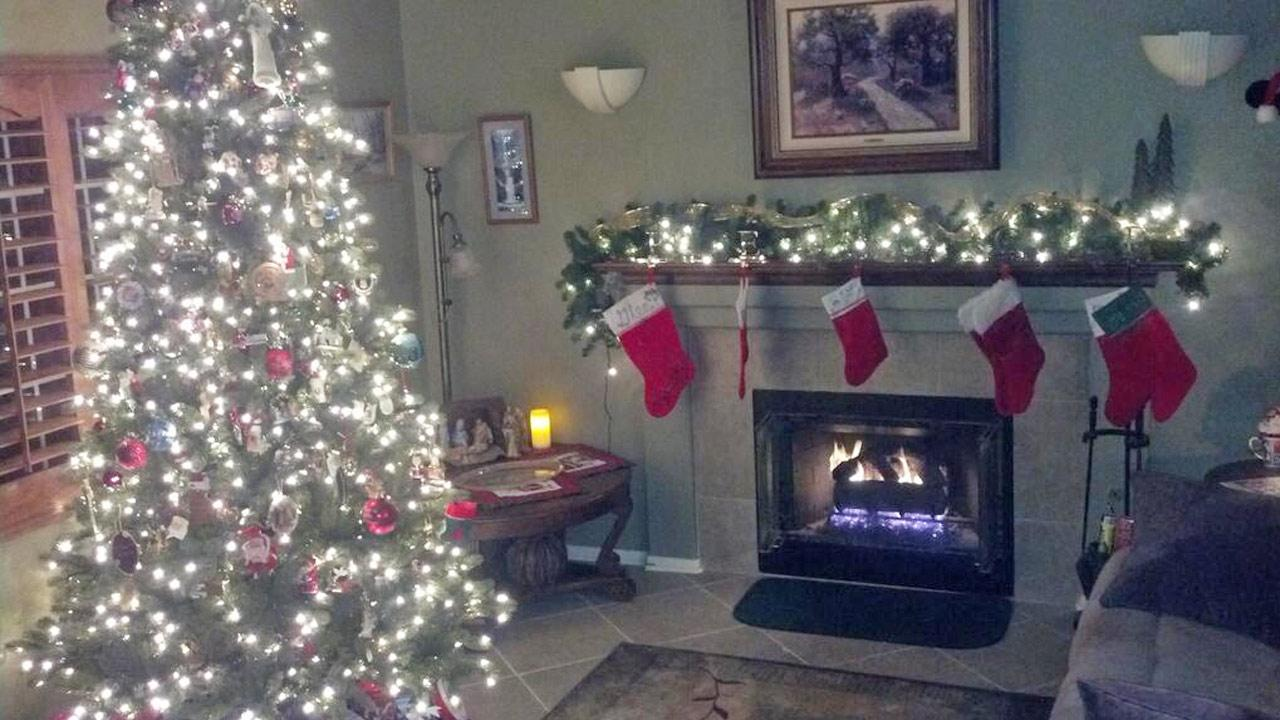 ABC7 viewer Glen Carter shared this snapshot of a lit Christmas tree and stockings hung on the fireplace mantle. <span class=meta>(ABC7 viewer Glen Carter)</span>