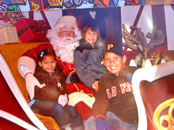 "<div class=""meta ""><span class=""caption-text "">Andrew, Kylie, and baby Oscar pose with Santa after giving him their Christmas lists. Merry Christmas boys, Love mom. (ABC7 Photo/ Artemisa Ramos)</span></div>"