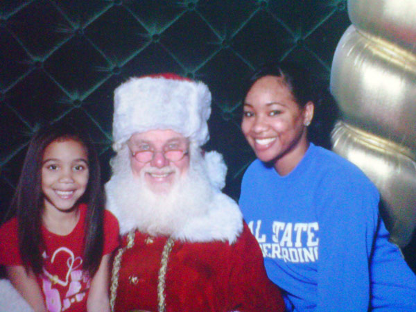 Happy holidays from Denise Johnson. &#39;Me and my little sister taking christmas pictures with Santa. This was her first time doing this. She loved it.&#39; <span class=meta>(ABC7 Photo&#47; Denise Johnson)</span>