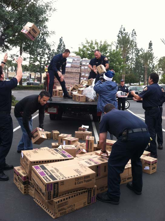 The L.A. County Fire Department helps out at the &#39;Spark of Love Toy Drive&#39; at Los Cerritos Center on Friday, Nov. 18, 2011. <span class=meta>(KABC Photo)</span>