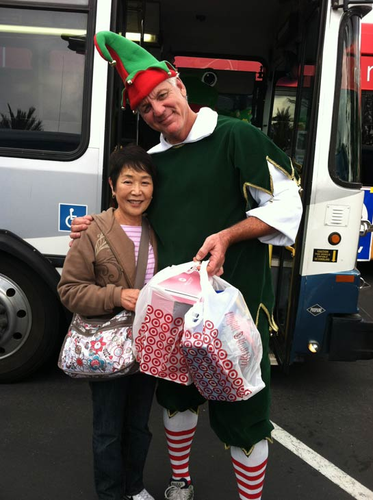 Garth the Elf poses with a woman at the &#39;Spark of Love Toy Drive&#39; at Los Cerritos Center on Friday, Nov. 18, 2011. <span class=meta>(KABC Photo)</span>