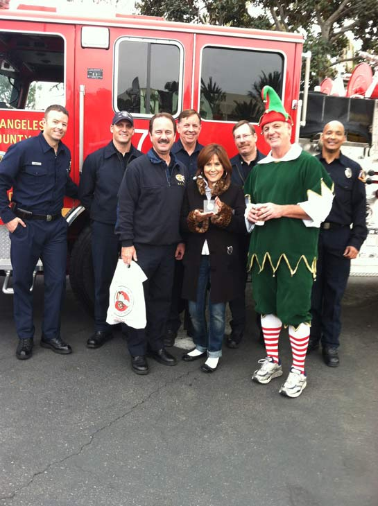 The L.A. County Fire Department presents Garth the elf a plaque at the &#39;Spark of Love Toy Drive&#39; at Los Cerritos Center on Friday, Nov. 18, 2011. <span class=meta>(KABC Photo)</span>