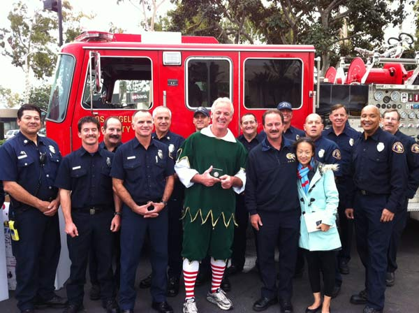 "<div class=""meta ""><span class=""caption-text "">The L.A. County Fire Department presents Garth the elf a plaque at the 'Spark of Love Toy Drive' at Los Cerritos Center on Friday, Nov. 18, 2011. (KABC Photo)</span></div>"