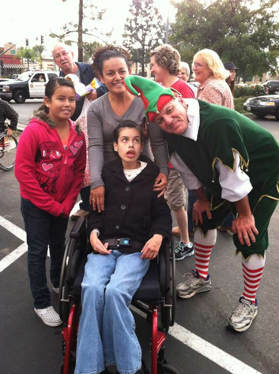 Garth the Elf poses with a group at the &#39;Spark of Love Toy Drive&#39; at Los Cerritos Center on Friday, Nov. 18, 2011. <span class=meta>(KABC Photo)</span>