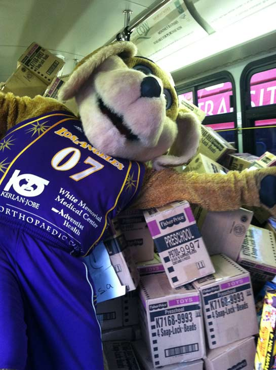 "<div class=""meta ""><span class=""caption-text "">Sparky, the mascot for the Los Angeles Sparks, poses inside the fourth stuffed bus at the 'Spark of Love Toy Drive' at Los Cerritos Center on Friday, Nov. 18, 2011. (KABC Photo)</span></div>"