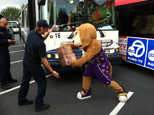 Sparky, the mascot for the Los Angeles Sparks, helps out at the &#39;Spark of Love Toy Drive&#39; at Los Cerritos Center on Friday, Nov. 18, 2011. <span class=meta>(KABC Photo)</span>