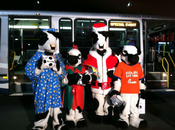 The Chick-fil-A family helps Garth the Elf &#39;Stuff-A-Bus&#39; at the &#39;Spark of Love Toy Drive&#39; at Los Cerritos Center  on Friday, Nov. 18, 2011. <span class=meta>(KABC Photo)</span>
