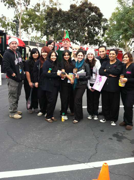 Downey Makeup Academy joins Garth the Elf to &#39;Stuff-A-Bus&#39; full of toys at Los Cerritos Center on Nov. 18, 2011. <span class=meta>(KABC Photo)</span>