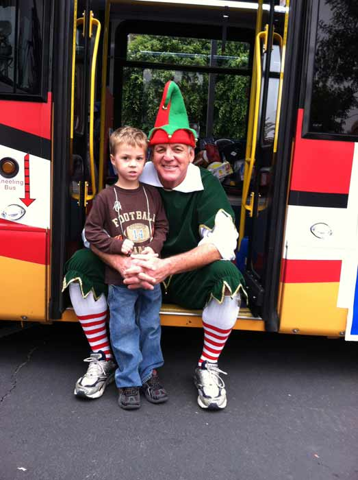 Jayden joins Garth the Elf to &#39;Stuff-A-Bus&#39; full of toys at Los Cerritos Center on Nov. 18, 2011. <span class=meta>(KABC Photo)</span>