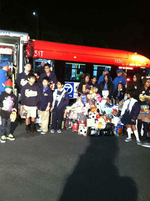 Students join Garth the Elf to &#39;Stuff-A-Bus&#39; full of toys and gifts at Los Cerritos Center  on Friday, Nov. 18, 2011. <span class=meta>(KABC Photo)</span>