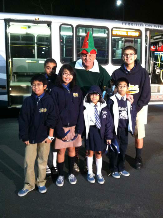 Students from Our Lady of Fatima in Artesia join Garth the Elf to &#39;Stuff-A-Bus&#39; at Los Cerritos Center  on Friday, Nov. 18, 2011. <span class=meta>(KABC Photo)</span>