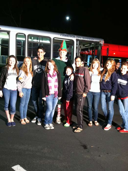 Students from Mayfair High School in Lakewood join Garth the Elf to &#39;Stuff-A-Bus&#39; full of toys at Los Cerritos Center  on Nov. 18, 2011. <span class=meta>(KABC Photo)</span>