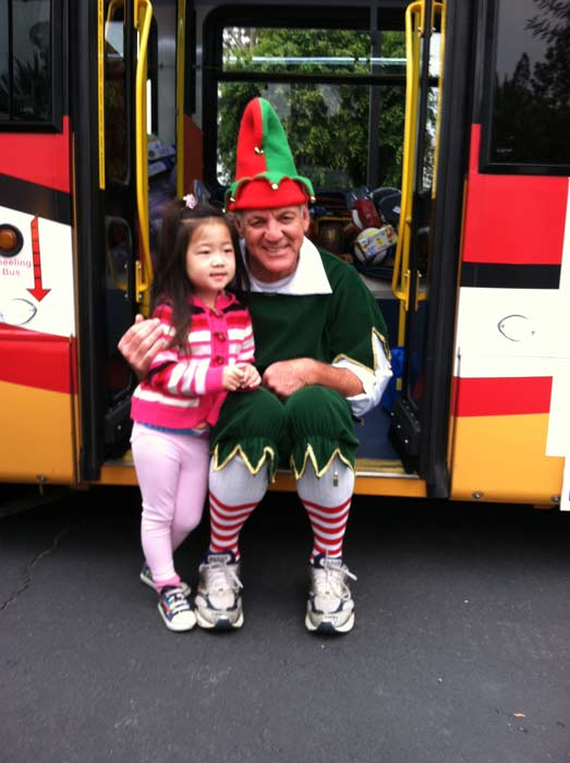 Sara joins Garth the Elf to &#39;Stuff-A-Bus&#39; full of toys at Los Cerritos Center  on Nov. 18, 2011. <span class=meta>(KABC Photo)</span>