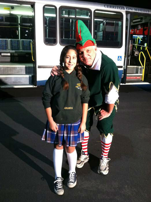 Student Amanda joins Garth the Elf to &#39;Stuff-A-Bus&#39; full of toys at Los Cerritos Center  on Nov. 18, 2011. <span class=meta>(KABC Photo)</span>