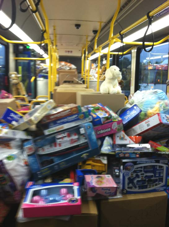 The first bus is stuffed at the &#39;Spark of Love Toy Drive&#39; at Mathis Brothers in Ontario on Friday, Dec. 2, 2011. <span class=meta>(KABC Photo)</span>