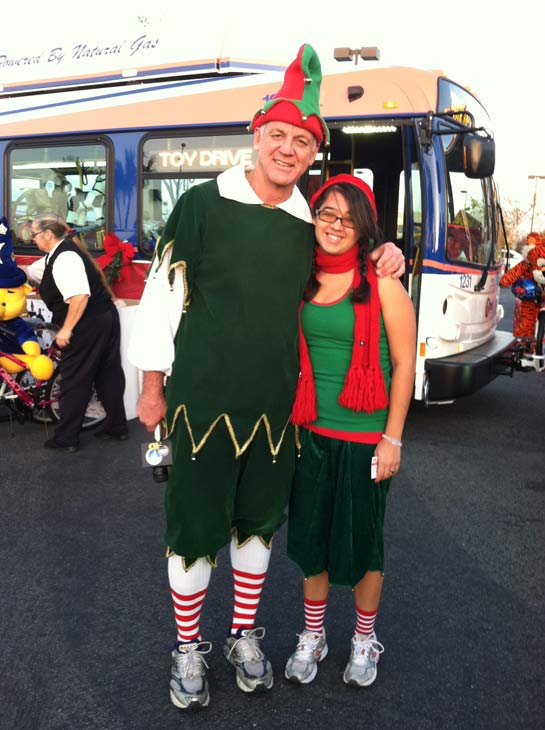 Garth the Elf poses with Christiana the Elf at the &#39;Spark of Love Toy Drive&#39; at Mathis Brothers in Ontario on Friday, Dec. 2, 2011. <span class=meta>(KABC Photo)</span>