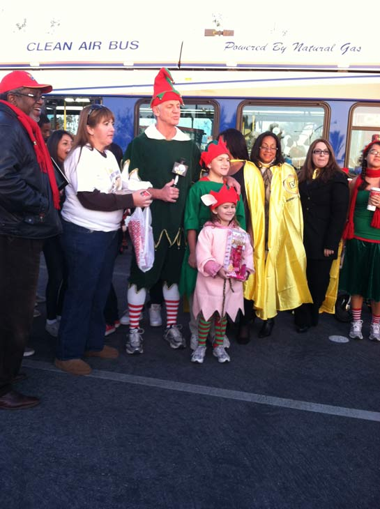 Garth the Elf poses with a group at the &#39;Spark of Love Toy Drive&#39; at Mathis Brothers in Ontario on Friday, Dec. 2, 2011. <span class=meta>(KABC Photo)</span>