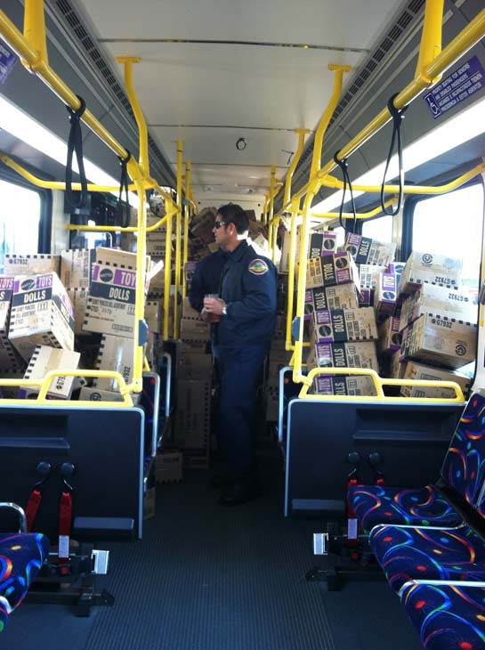 The third bus gets full at the &#39;Spark of Love Toy Drive&#39; at Mathis Brothers in Ontario on Friday, Dec. 2, 2011. <span class=meta>(KABC Photo)</span>