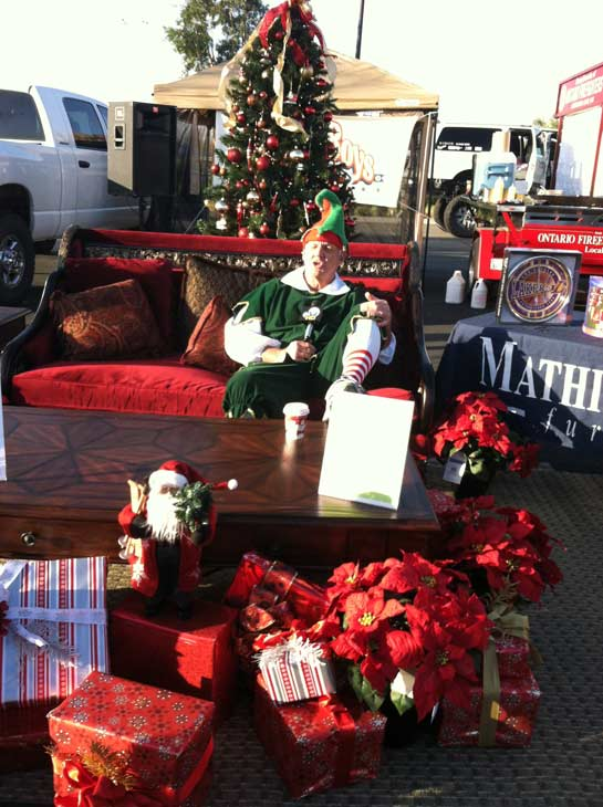 "<div class=""meta ""><span class=""caption-text "">Garth the Elf hangs out at the 'Spark of Love Toy Drive' at Mathis Brothers in Ontario on Friday, Dec. 2, 2011. (KABC Photo)</span></div>"