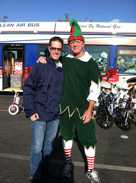 ABC7 Inland Empire Bureau Chief Rob McMillan poses with Garth the Elf at the &#39;Spark of Love Toy Drive&#39; at Mathis Brothers in Ontario on Friday, Dec. 2, 2011. <span class=meta>(KABC Photo)</span>
