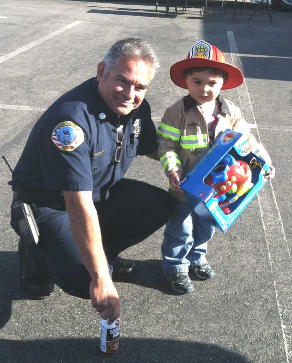 An Ontario firefighter poses with a young firefighter at the &#39;Spark of Love Toy Drive&#39; at Mathis Brothers in Ontario on Friday, Dec. 2, 2011. <span class=meta>(KABC Photo)</span>