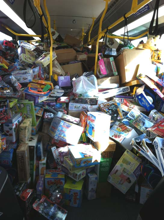 "<div class=""meta ""><span class=""caption-text "">The third bus is stuffed at the 'Spark of Love Toy Drive' at Mathis Brothers in Ontario on Friday, Dec. 2, 2011. (KABC Photo)</span></div>"